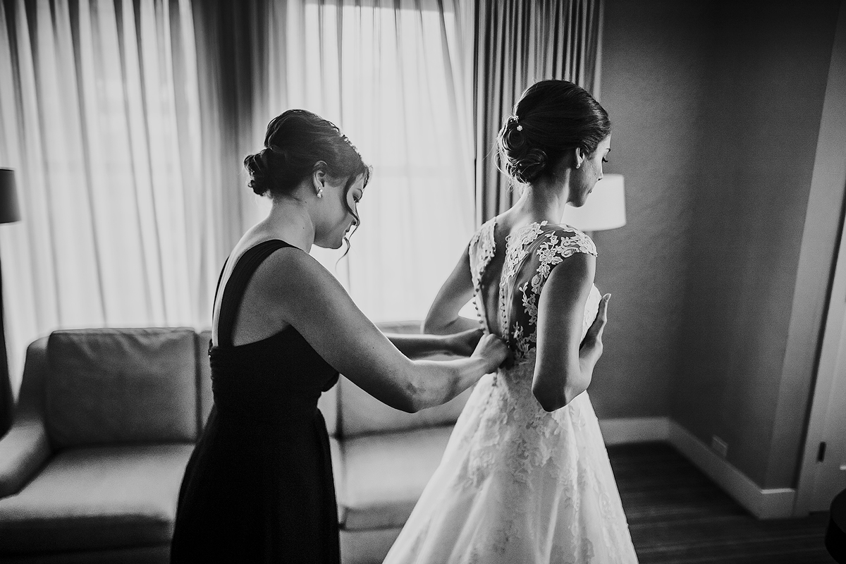Bride-Getting-Into-Dress